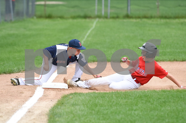 081417 Wesley Bunnell | Staff The Edgewood Phillies vs the McCabe-Waters Red Sox on Monday evening at Peck Park's Watson Field in the first game of the Little League City Series. Red Sox third baseman Anthony Ricciuti (12) applies the tag on the Phillies runner on an attempted steal.