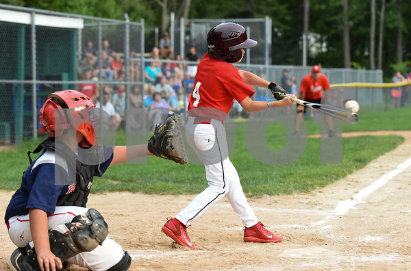 081417 Wesley Bunnell | Staff The Edgewood Phillies vs the McCabe-Waters Red Sox on Monday evening at Peck Park's Watson Field in the first game of the Little League City Series. Phillies James Myers (4) with a double.