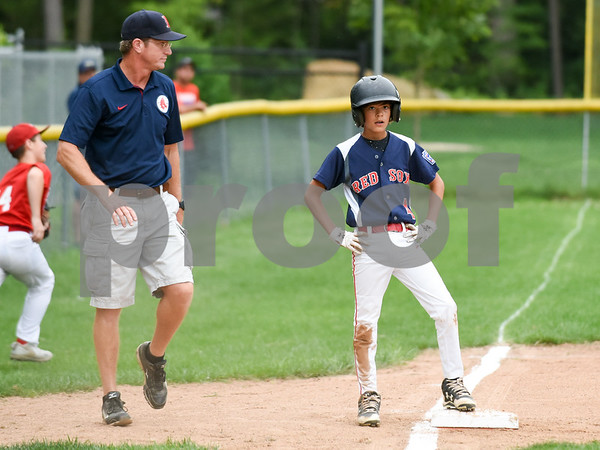 081417 Wesley Bunnell | Staff The Edgewood Phillies vs the McCabe-Waters Red Sox on Monday evening at Peck Park's Watson Field in the first game of the Little League City Series. Red Sox Jay Fedor (4) stands on third base with a triple.