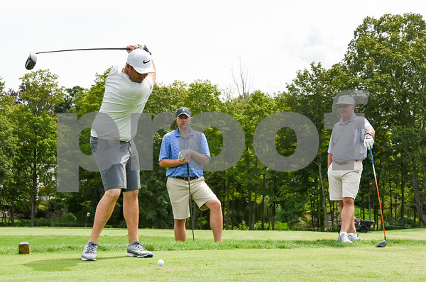 081417 Wesley Bunnell | Staff Head golf professional Tim Gavronski of Shuttle Meadow Country Club held 100 Holes for Junior Golf on Monday afternoon to raise funds for the CT PGA Golf Foundations which supports Junior golf in CT. Also participating with Tim were Kyle Hedstrom of Stanley Golf Course and Marc Bayram of Timberlin Golf Course. Marc Bayram tees off on the 18th hole as Hedstrom and Tim Gavronski look on.