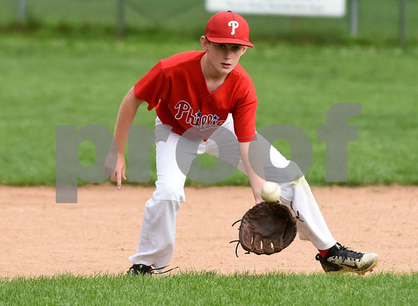 081417 Wesley Bunnell | Staff The Edgewood Phillies vs the McCabe-Waters Red Sox on Monday evening at Peck Park's Watson Field in the first game of the Little League City Series. Phillies Brian Wilson (11) fields a ground ball.