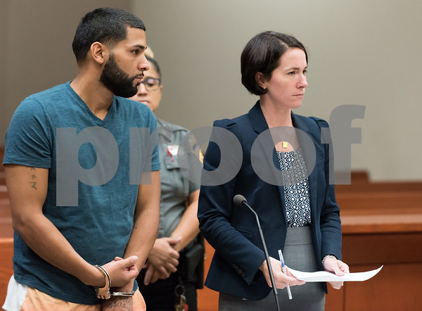 081417 Wesley Bunnell | Staff Pedro Maldonado, 33, of Bristol stands with his attorney as he is being arraigned in front of Judge Joan Alexander in New Britain Superior Court on Monday afternoon. During a traffic stop last Friday afternoon Maldonado pulled away dragging a New Britain Police Officer for a short distance.