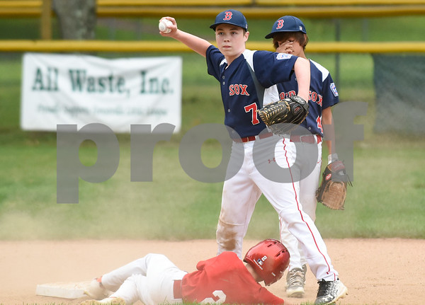 081417 Wesley Bunnell | Staff The Edgewood Phillies vs the McCabe-Waters Red Sox on Monday evening at Peck Park's Watson Field in the first game of the Little League City Series. Phillies Michael McMahon is tagged out at second base by the Red Sox Logan Crowley (7).