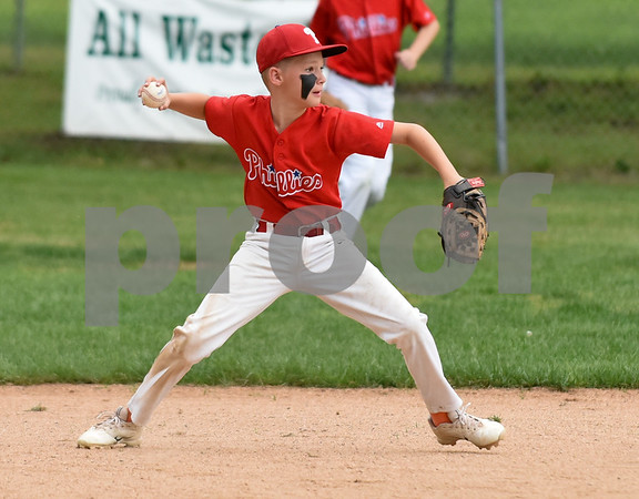 081417 Wesley Bunnell | Staff The Edgewood Phillies vs the McCabe-Waters Red Sox on Monday evening at Peck Park's Watson Field in the first game of the Little League City Series. Phillies Michael McMahon (2) throws to first for the out.