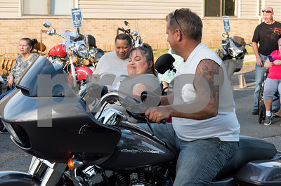081717  Wesley Bunnell | Staff  Lucy Rivera revs the engine on Mark Pinkham's motorcycle during motorcycle night at Autumn Lake Healthcare in New Britain. The night let residents get up close looks at motorcycles and featured food and prizes for the best motorcycle.