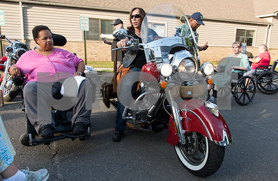 081717  Wesley Bunnell | Staff  Mary Mixter of the Out Spoken Girlz Motorcycle Club, center, speaks to residents at the Autumn Lake Healthcare facility in New Britain on Thursday evening. The event allowed residents an up close look at motorcycles and featured food and prizes.