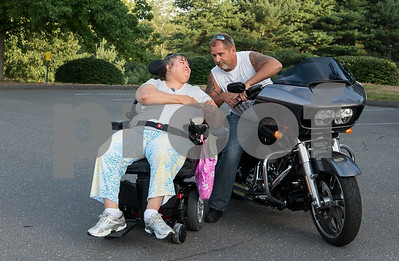 081717  Wesley Bunnell | Staff  Lucy Rivera speaks with Mark Pinkham during motorcycle night at Autumn Lake Healthcare in New Britain. The night let residents get up close looks at motorcycles and featured food and prizes for the best motorcycle.