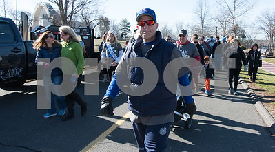 040217  Wesley Bunnell | Staff  Team Johnson Walk took place on Sunday April 2, 2017 in Walnut Hill Park. 100% of the proceeds collected are being donated to the Fight Colorectal Cancer Foundation. The walk was organized by Caroline Johnson, wife of New Britain Firefighter Scott Johnson, who is currently being treated for the disease. Scott Johnson leads the group at the start of the walk.