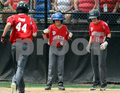 8/11/2017 Mike Orazzi | Staff South Portland American Little League's Matthew Fogg (44) after his home run is greeted by Ben Stanley (9) and Tim Crockett (11) during the Eastern Regional Little League game at Breen Field in Bristol Friday.