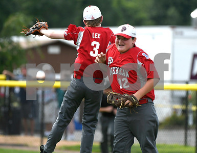 8/11/2017 Mike Orazzi | Staff South Portland American Little League's Aiden Lee (3) and Richie Gilboy (12) celebrate a win over New Hampshire during the Eastern Regional Little League game at Breen Field in Bristol Friday.