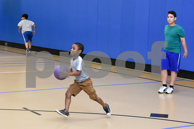 081117  Wesley Bunnell | Staff  Seven year old Cecil Aidoo nicknamed Little Big Man keeps up with the older kids during a dodge ball game at The Boys & Girls Club of New Britain on Friday afternoon.