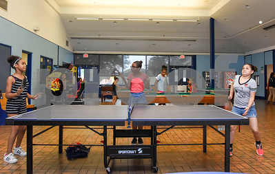 081117  Wesley Bunnell | Staff  Franshezca de la Cruz, age 11 L, plays ping pong against Alexa Sengchanh, age 11, as Zuleyka Vargas, age 9 middle, keeps score at The Boys & Girls Club of New Britain on Friday afternoon.