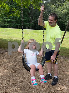 081117  Wesley Bunnell | Staff  Briana, age 2, gets pushed in her swing by dad Darek at Stanley Quarter Park on Friday afternoon.