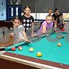 081117  Wesley Bunnell | Staff<br /> <br /> Yamaris Nevarez, age 8, sticks her tongue out as she shoots in a game of pool alongside Aymara Soler, age 10, and Brooke Barriault, age 8, at The Boys & Girls Club of New Britain on Friday afternoon.