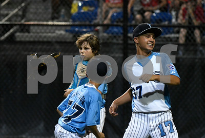 8/11/2017 Mike Orazzi | Staff Maryland's Peyton Castellow (77), DJ Shipton (35) and Logan Simanski (17) celebrate a win over  PA during the Eastern Regional Little League Tournament at Breen Field in Bristol Friday night.