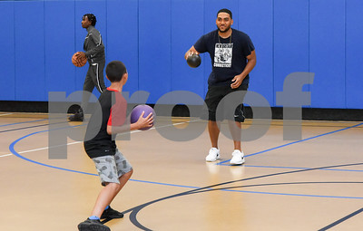 081117  Wesley Bunnell | Staff  Alexis Rivera, L, readies to throw at employee Kenny Noyola during a game of dodge ball at The Boys & Girls Club of New Britain on Friday afternoon.