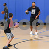 081117  Wesley Bunnell | Staff<br /> <br /> Alexis Rivera, L, readies to throw at employee Kenny Noyola during a game of dodge ball at The Boys & Girls Club of New Britain on Friday afternoon.