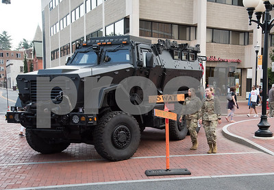 080117  Wesley Bunnell | Staff  The New Britain Police Department hosted their annual National Night Out event in downtown New Britain on Tuesday night. The night featured activities, demonstrations and giveaways including a barbecue to encourage residents to help stop crime. Soldiers walk past a New Britain SWAT vehicle.