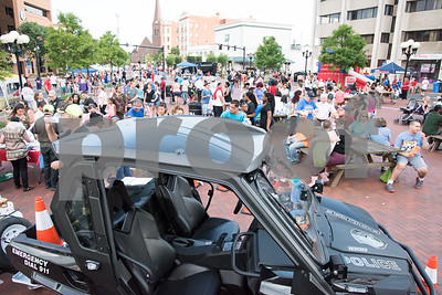 080117  Wesley Bunnell | Staff  The New Britain Police Department hosted their annual National Night Out event in downtown New Britain on Tuesday night. The night featured activities, demonstrations and giveaways including a barbecue to encourage residents to help stop crime. A police off road vehicle is shown with crowds gathered at Central Park.