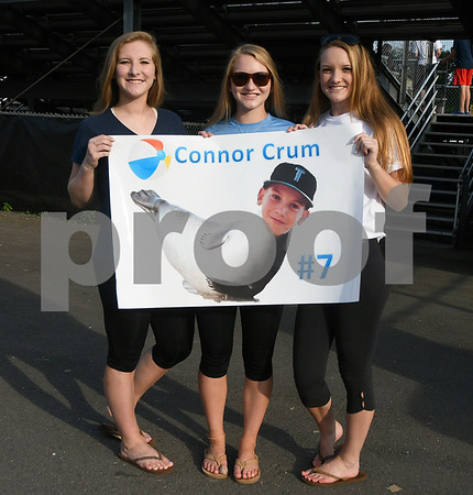 8/12/2017 Mike Orazzi | Staff Sisters Hayley, Taylor and Olivia Crum hold a sign for their brother Connor (7) before the start of the Mid-Atlantic Regional Final during the Eastern Regional Little League Tournament at Breen Field in Bristol Saturday night.
