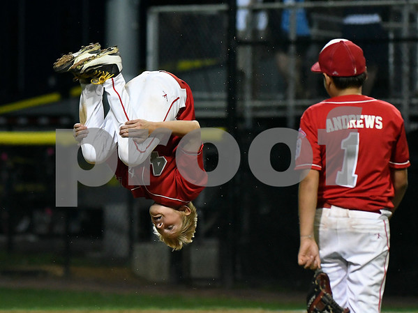 8/12/2017 Mike Orazzi | Staff New Jerseys Ryan Kinsman (4) does a back flip after winning the Mid-Atlantic Regional Final at the Eastern Regional Little League Tournament at Breen Field in Bristol Saturday night.