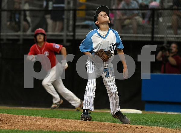 8/12/2017 Mike Orazzi | Staff Marylands Peyton Castellow (77) watches a fly ball during the Mid-Atlantic Regional Final at the Eastern Regional Little League Tournament at Breen Field in Bristol Saturday night.