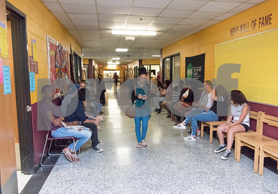 081517  Wesley Bunnell | Staff  New Britain High School students and family members line the hallway in the guidance section on Tuesday afternoon to meet with their counselor.