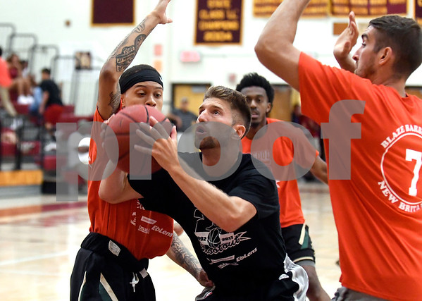 8/19/2017 Mike Orazzi | Staff Peter Skevas under the hoop during the Osgood Shootout at New Britain High School Saturday.