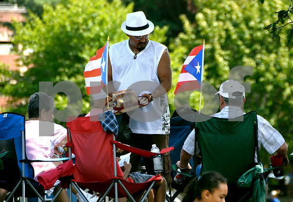 8/19/2017 Mike Orazzi | Staff Angel Hernandez shows off his new hats bought during the citys second annual Latin Festival in New Britain Saturday.