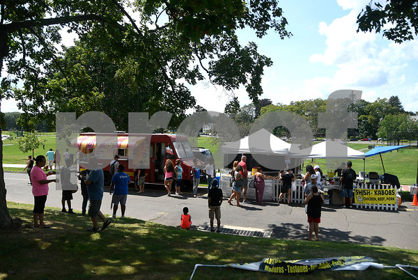 8/19/2017 Mike Orazzi | Staff Food trucks and other food vendors line the way in Walnut Hill Park during the city's second annual Latin Festival in New Britain Saturday.