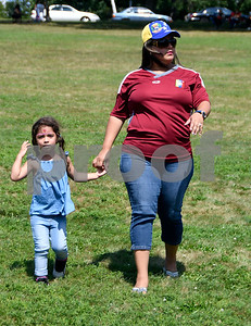 8/19/2017 Mike Orazzi | Staff Luizori Martinez and her daughter Genesis,4,  during the city's second annual Latin Festival in New Britain Saturday.