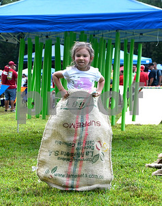 8/19/2017 Mike Orazzi | Staff Keeva Knowles hops around in a sack during the Rockwell Park Summer Festival 2017 hosted by West End Association of Bristol Saturday.