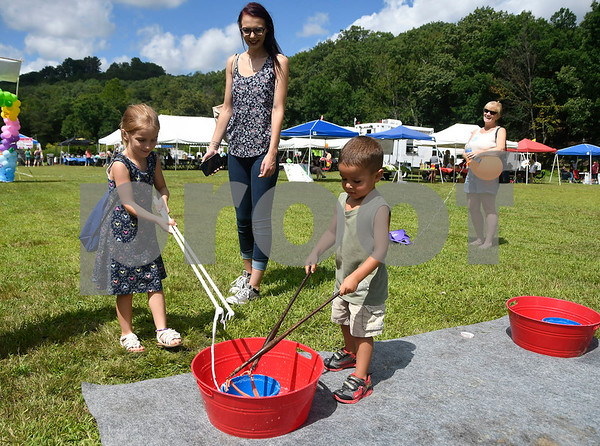 8/19/2017 Mike Orazzi | Staff Kasia Lajoie as her daughter Dreah,6 and Jorden Calvo,4, make bubbles during the Rockwell Park Summer Festival 2017 hosted by West End Association of Bristol Saturday.