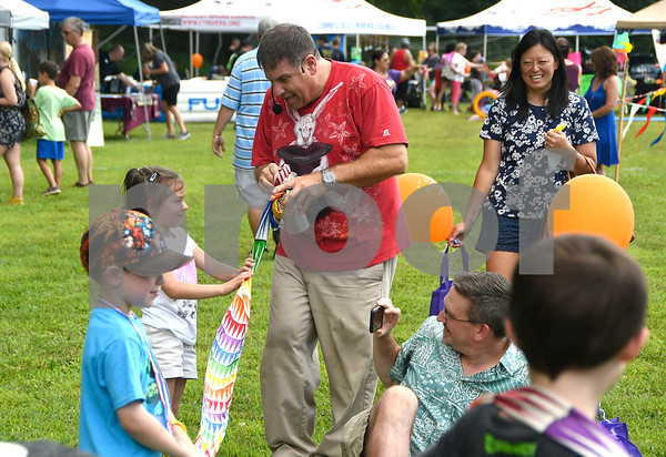 8/19/2017 Mike Orazzi | Staff Ed Popielarczyk performs magic tricks during the Rockwell Park Summer Festival 2017 hosted by West End Association of Bristol Saturday.