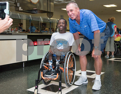 080217  Wesley Bunnell | Staff  Retired tennis professional Ivan Lendl poses for a photo with camper Delmace Mayo at the Hospital for Special Care Ivan Lendl Adaptive Sports Camp on Wednesday afternoon at the University of St. Joseph in West Hartford.