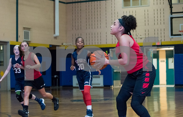 Adriana Faienca (2) of the CT Heat looks to shoot against the CT Spirit on Wednesday night at Roosevelt School in a 12U Nutmeg State Games competition.