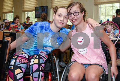 080217  Wesley Bunnell | Staff  Natalia Jablonski, L, and Maggie Fusco at the Hospital for Special Care Ivan Lendl Adaptive Sports Camp on Wednesday afternoon at the University of St. Joseph in West Hartford.