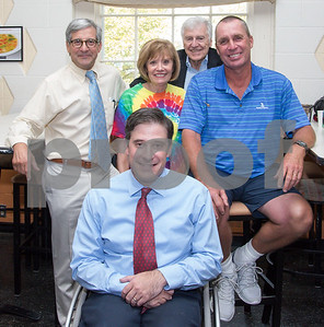 080217  Wesley Bunnell | Staff  Chief of Staff for the Hospital for Special Care John Votto, L, Janeace Slifka, Bob Slifka, retired professional tennis player Ivan Lendl and Jonathan Slifka, front, pose for a photo at the Hospital for Special Care Ivan Lendl Adaptive Sports Camp on Wednesday afternoon at the University of St. Joseph in West Hartford. Janeace and Bob Slifka helped founded the camp. Jonathan was the Connecticut poster child in 1988 for the March of Dimes campaign and featured in the photo with Ivan Lendl.