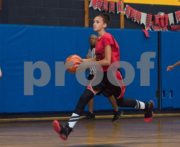 Kameryn Perry (13) of the CT Heat brings the ball downcourt against the CT Spirit on Wednesday night at Roosevelt School in a 12U Nutmeg State Games competition.