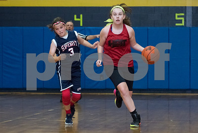 Morgan Murphy (11) of the CT Heat with the ball against the CT Spirit on Wednesday night at Roosevelt School in a 12U Nutmeg State Games competition.
