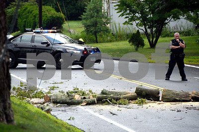8/2/2017 Mike Orazzi | Staff A partially closed Route 262 in Plymouth Wednesday afternoon after a strong storm moved through the area downing several trees in the Plymouth area.