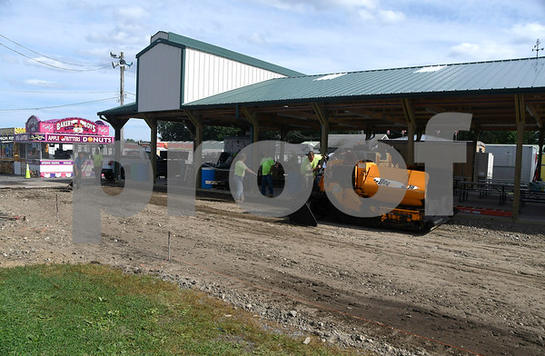 8/23/2017 Mike Orazzi | Staff A crew paves the area near the pavilion in the area of the chicken BBQ at the Terryville Country Fair. The fair kicks off Friday.