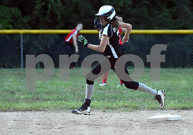 8/24/2017 Mike Orazzi | Staff Nitro's Hannah Webber (7) on her way to third during the city series Thursday night.