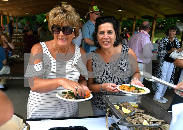 8/24/2017 Mike Orazzi | Staff Linda DiMatteo and Jill Fitzgerald during the annual Crocodile Club Dinner meeting presented by the New England Carousel Museum at Lake Compounce Thursday afternoon.