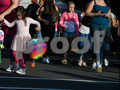8/25/2017 Mike Orazzi | Staff Ayah Bentammar,5, carries an inflatable balloon she got at the Plainville Fire Company Hot Air Balloon Festival held in Norton Park Friday night.