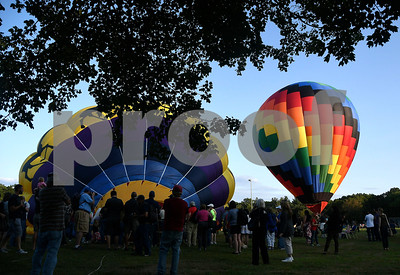 8/25/2017 Mike Orazzi | Staff Tethered balloons at the Plainville Fire Company Hot Air Balloon Festival held in Norton Park Friday night.