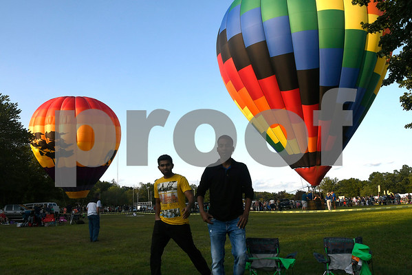 8/25/2017 Mike Orazzi | Staff Sai Polimera and Charan Akiri at the Plainville Fire Company Hot Air Balloon Festival held in Norton Park Friday night.