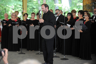 8/26/2017 Mike Orazzi | Staff Adrian Sylveen conducts members of the Chór Moniuszko during the Annual Dozynki Festival at Falcon Field in New Britain on Saturday.