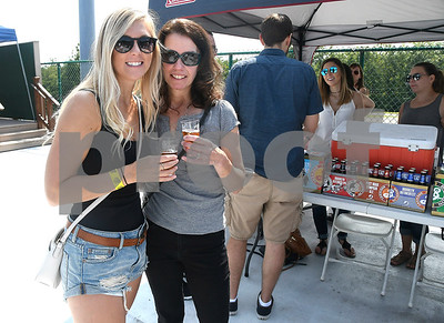 8/26/2017 Mike Orazzi | Staff Bethany Dumez and her aunt Teresa Nicholson during Beers in the Ballpark at New Britain Stadium Saturday.