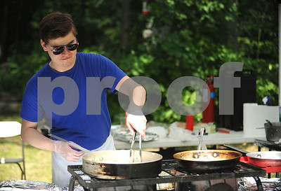 8/26/2017 Mike Orazzi | Staff The Baltic Restaurant's Aaron Dwyer cooks potato pancakes during the Annual Dozynki Festival at Falcon Field in New Britain on Saturday.